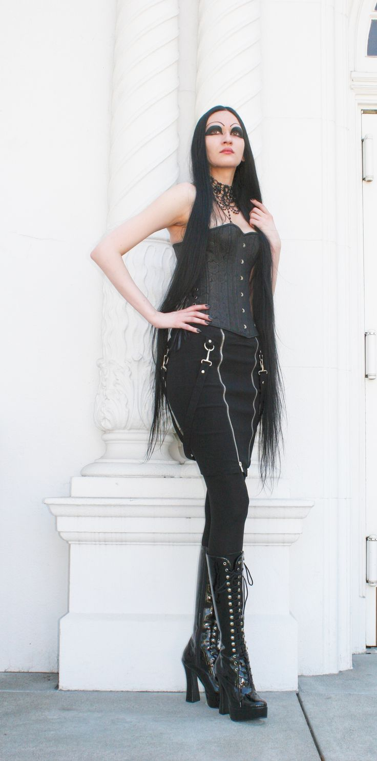 Triana in Lip Service skirt and Timeless Trends corset with Restyle necklace available at www.