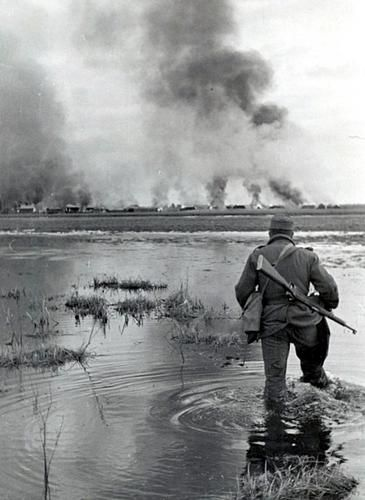 A soldier of the 2nd Hungarian Army wades in the shallow part of the Don river. As the result of the large-scale Soviet attack, the Army was forced to retreat to the second line of defense. During the fighting on the Don river area, the Hungarians suffered heavy losses.