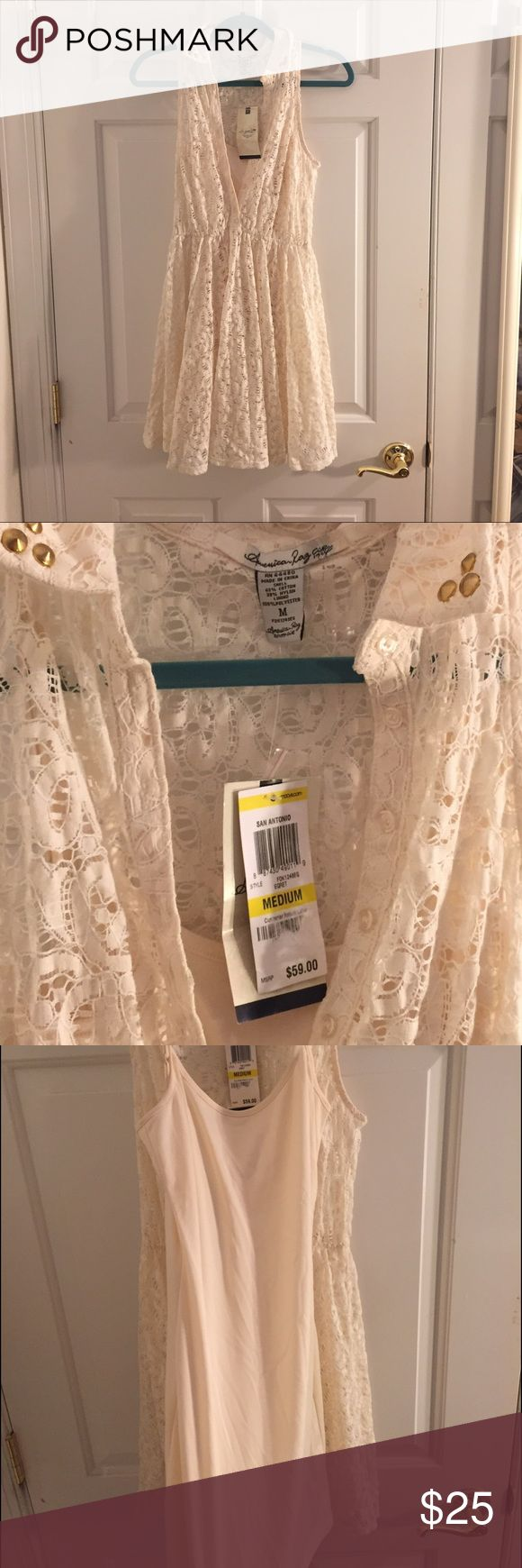 American Rag cream mini dress medium American Rag cream mini dress medium. Never worn net. It has a lace outer layer and then an inner layer to cover up. It's a really beautiful dress. American Rag Dresses Mini