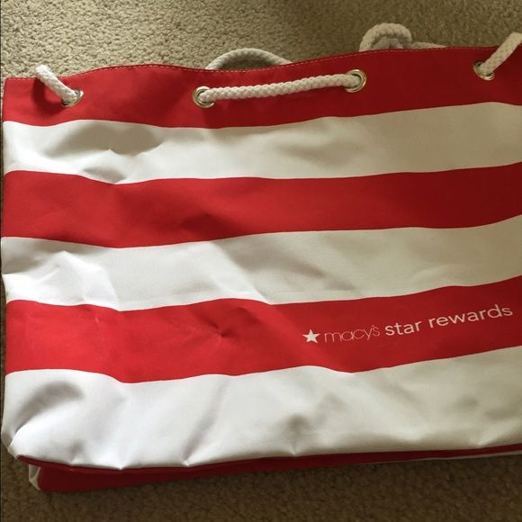 Macy's Star Rewards oversize beach bag Red and white striped oversize beach bag with soft white rope handle. Measures 15 inches from top to bottom. 20 1/2 inches across. Really nice size for beach or water fun excursions. Please note it has a few marks on it that may come out in the wash. New never used. Macys Accessories