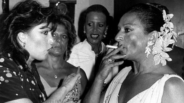 Lola Flores, famous spanish singer, smokes nervously with Massiel, eurovison winner on 1968. It was Lola Flores' daughter wedding day, 25th August 1983, Marbella