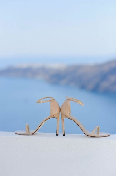 Wedding Shoes. Capture from Dreamy Wedding at Santorini Gem by Phosart Photography & Cinematography