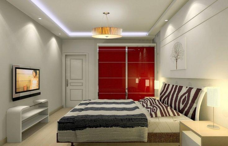 Deco Chambre Hippie : chambre rouge avec armoire de rangement et grand lit à motif zèbre