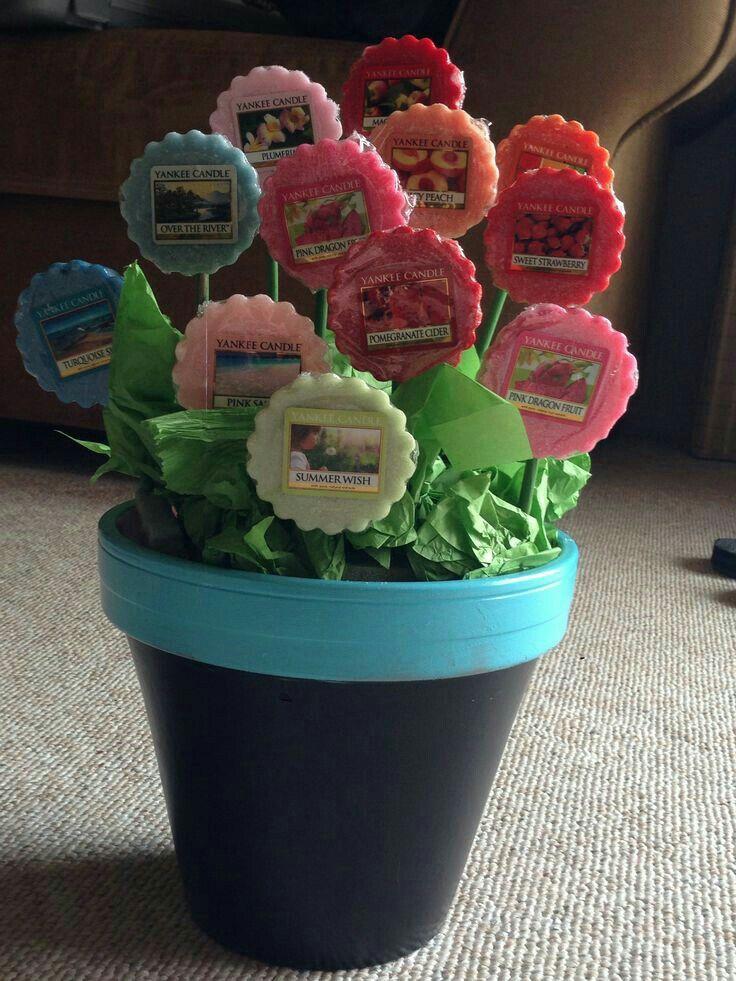Cute idea! Tea light candle flower arrangement