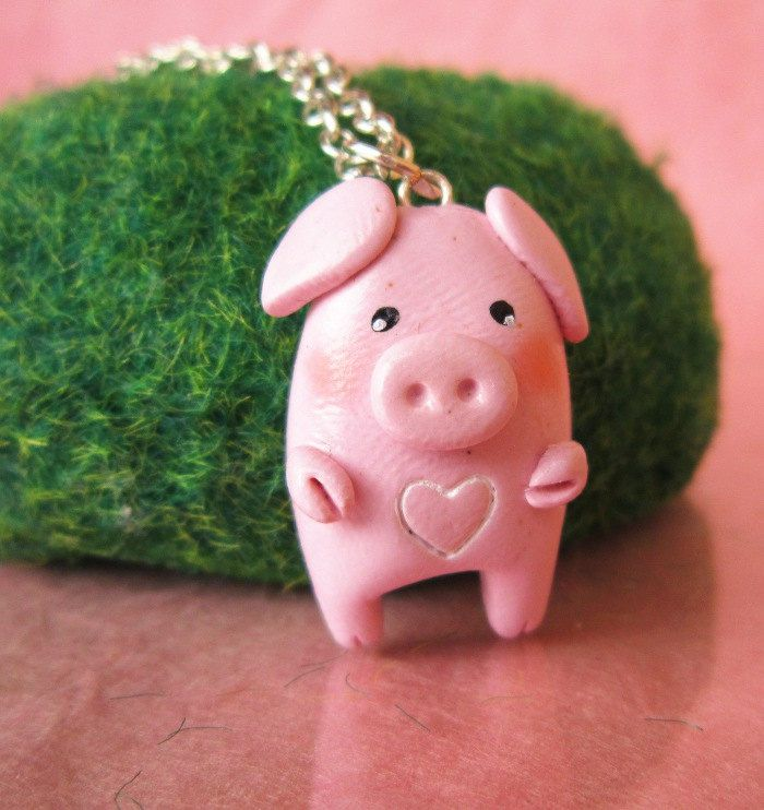 Polymer clay pig necklace, avail on Etsy but seems simple to make one for Maddie
