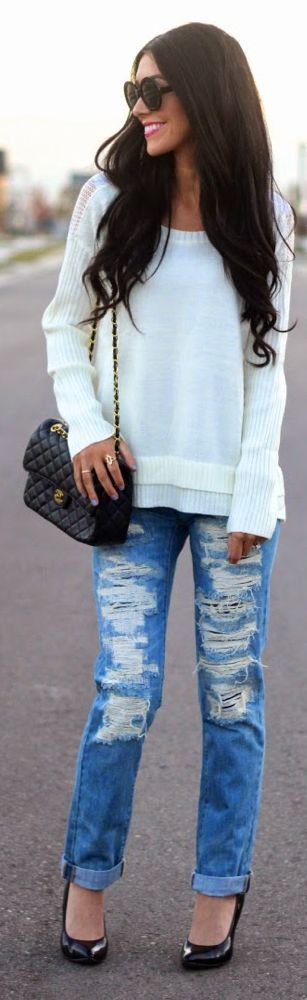 Distressed denim + white sweater.