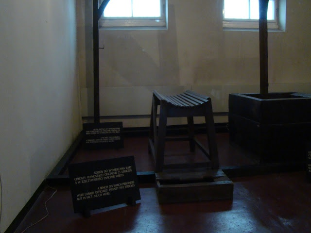 whipping benches on display in the Block 11 permanent exhibition display at the Auschwitz Museum and Memorial
