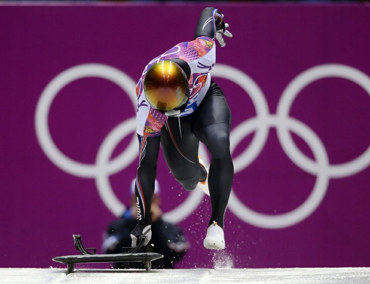 John Daly of the United States starts his second run during the men's skeleton competition at the 2014 Winter Olympics, Friday, Feb. 14, 2014, in Krasnaya Polyana, Russia. (AP Photo/Natacha Pisarenko)