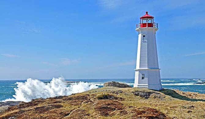 Louisbourg Lighthouse is a historic Canadian lighthouse at Louisbourg, Nova Scotia, and is the site of the first lighthouse in Canada.    Construction began on ... Get more information about the Louisbourg Lighthouse on Hostelman.com #attraction #Canada #landmark #travel #destinations #tips #packing #ideas #budget #trips