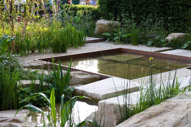Limestone boulder sunken square copper edged pond pool water feature naturalistic