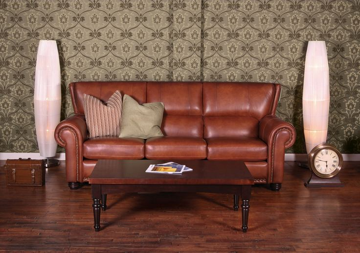 Windsor brow leather sofa with nails. Jaymar traditional model.