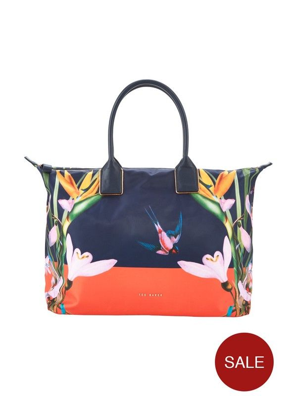 Ted Baker Tropical Oasis Tote Look to Ted Baker's tropical oasis tote to lend a luxe edge to your workout wardrobe. With colourblock detailing and a botanical print, it's a beautifully bold pick that holds more than enough room for your gym gear and other essentials, while grab handles and a slick silhouette can be quickly switched up for a day spent in the city after your morning yoga session.Keep things coordinated with matching tights and a tank top. Simply swap for a skater dress...