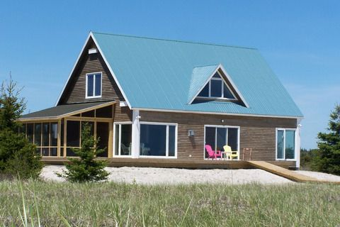Sanderling Beach House in Louis Head Nova Scotia is surrounded by sea and sand.  This cottage sleeps 6 people in 3 queen size beds.  #novascotia