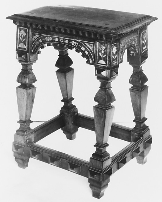 Stool    Date:      16th century  Culture:      English  Medium:      Inlaid wood  Dimensions:      23-3/8 x 18-11/16 x 11-5/16 in. (59.4 x 47.5 x 28.7 cm)  Classification:      Woodwork-Furniture  Credit Line:      Bequest of Irwin Untermyer, 1973  Accession Number:      1974.28.17