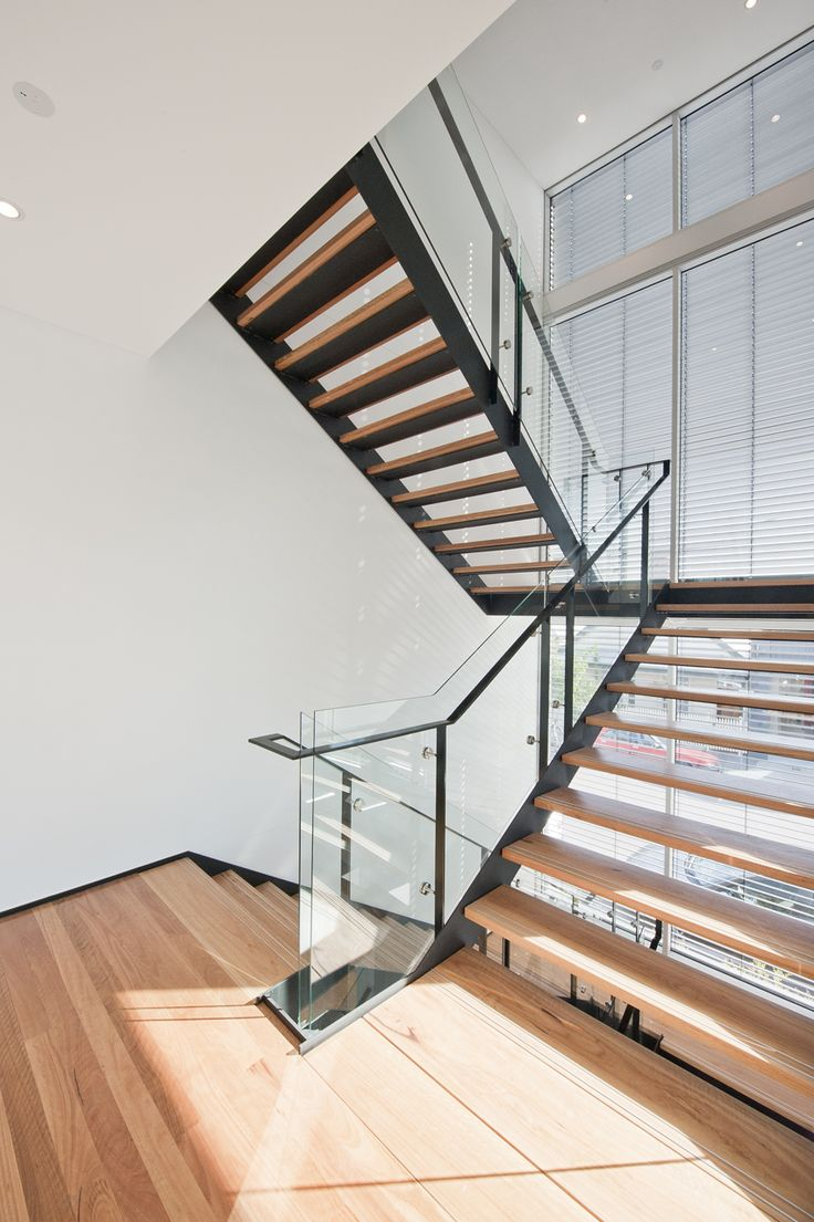 Cremorne Apartments| Melbourne | Black Steel Stringers | Glass Balustrade | Blackbutt Treads | Timber | Modern | Contemporary | Commercial | Nonslip Treads | Stained Finish | Simple | Stair