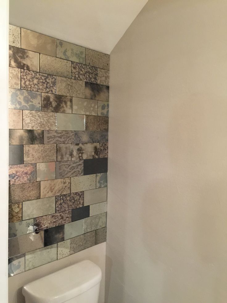 Watch this video and learn how to cut antique mirror tiles.