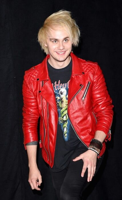 5 Seconds of Summer's Michael Clifford in blonde hair...