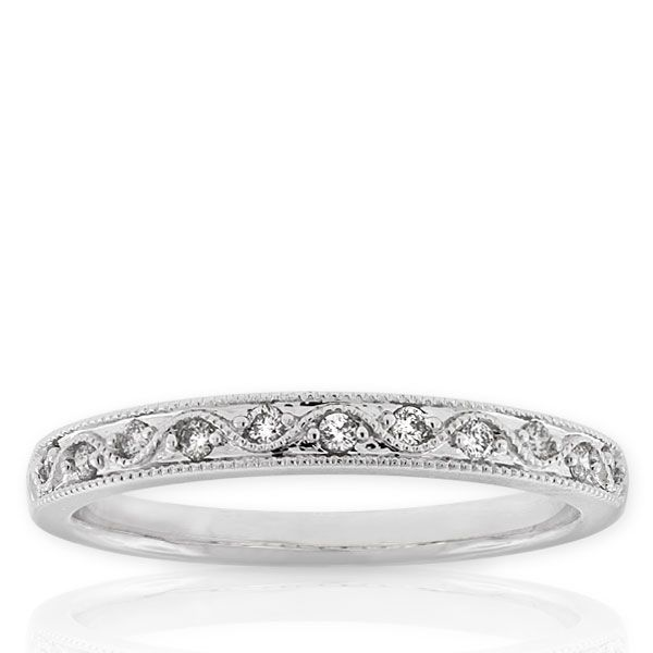 Wedding band?  Diamond Band 14K  Diamond ring, 1/10 carat total weight, in 14K white gold. Item Number: 11064086  $499.00