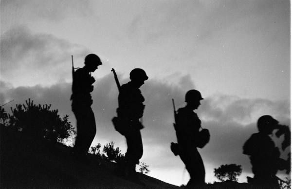 Soliders silhouetted in Korea, June 1952 (Michael Rougier)