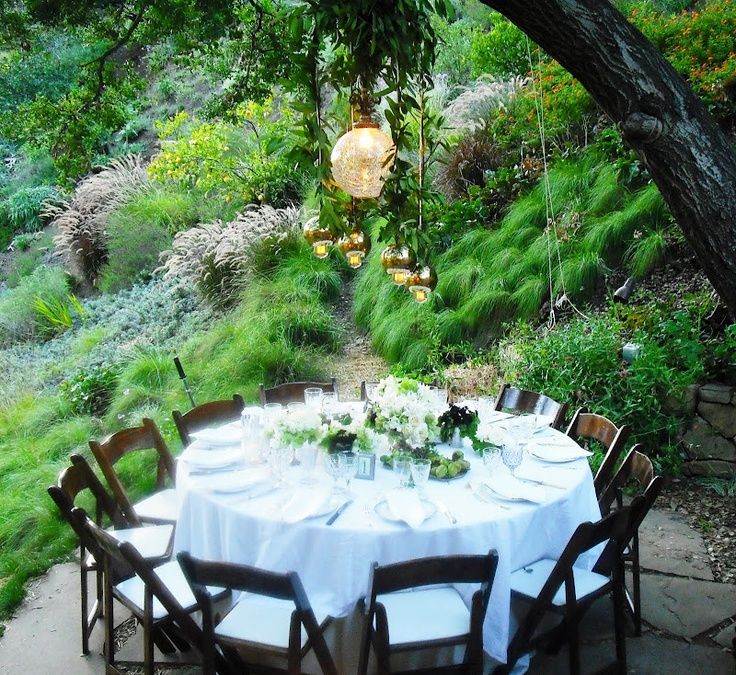 Outdoor round dining table at hillside wedding reception. http://cococozy.com