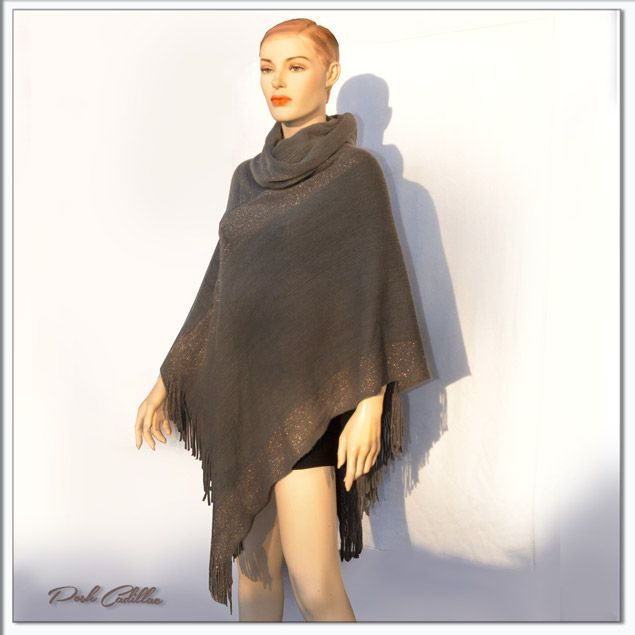 in Europe: Italy Size: One fits all Beautiful grey tone turtleneck cape top that can be worn as a sweater top or coat, on its own or with a short sleeve or long sleeve top. With elegant gold knitted detail stripes, this tassel top is an easy to wear top that adds style to an outfit and will look j