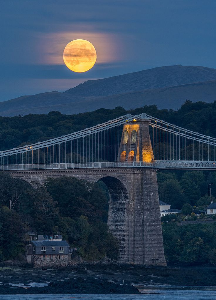 'Harvest Moon Over Menai Bridge'. Menai Bridge, Wales, United Kingdom.