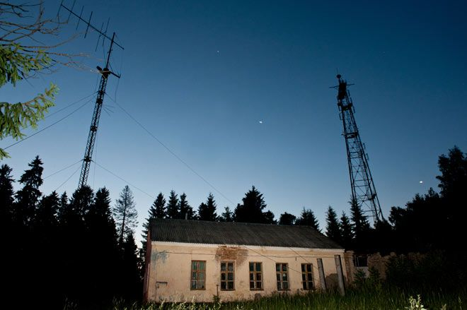 The most mysterious radio station in the world, ''UVB-76'' Has been permanently active since  the late 70's broadcasting from a house in Povarovo  Russia,the transmission includes a strange and monotone buzz that is interrupted every once in a while with murmurs, weird messages and microphone glitches. To this day nobody knows its purpose nor who is behind it.