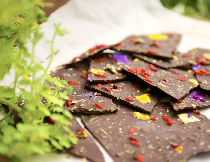 Raw Chocolate with Goji, Pistachios, Dehydrated Stinging Nettle and Pansy Petals. It's just one of those days.