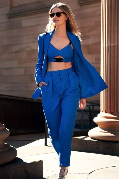 "Crop top/belly shirt with High waisted Solid color Pant. Jacket to cover up ad class up and throw some gold and black on it so so it doesn't look like you're part of the ""Blue Man Group"". It's in this season and if you have any laying around from 90's, than whip-em-out of your closet!"