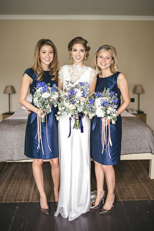 Bridesmaids in short blue dresses. Charlie Brear, 1930s vintage inspired wedding dress, September wedding, Laid back intimate wedding, Photography by Kat Hill