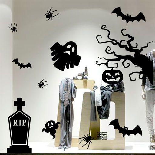 Terrorífico pack de vinilos decorativos para Halloween formado por arañas, murciélagos, una tumba, fantasmas y un árbol con una calabaza colgando.