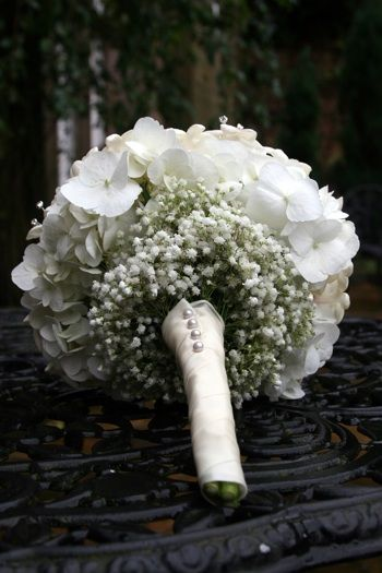 Wedding Flowers: Stephanotis, white hydrangea and a tight pinning of gypsophila (baby's breath).