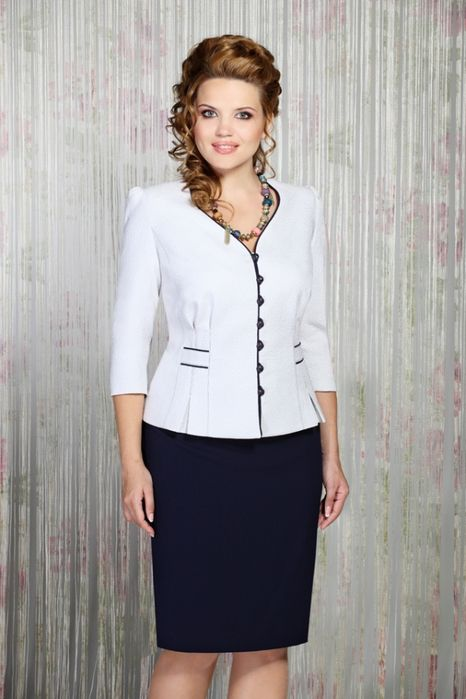 White blouse with black trimming on collar & the front and a matching black skirt