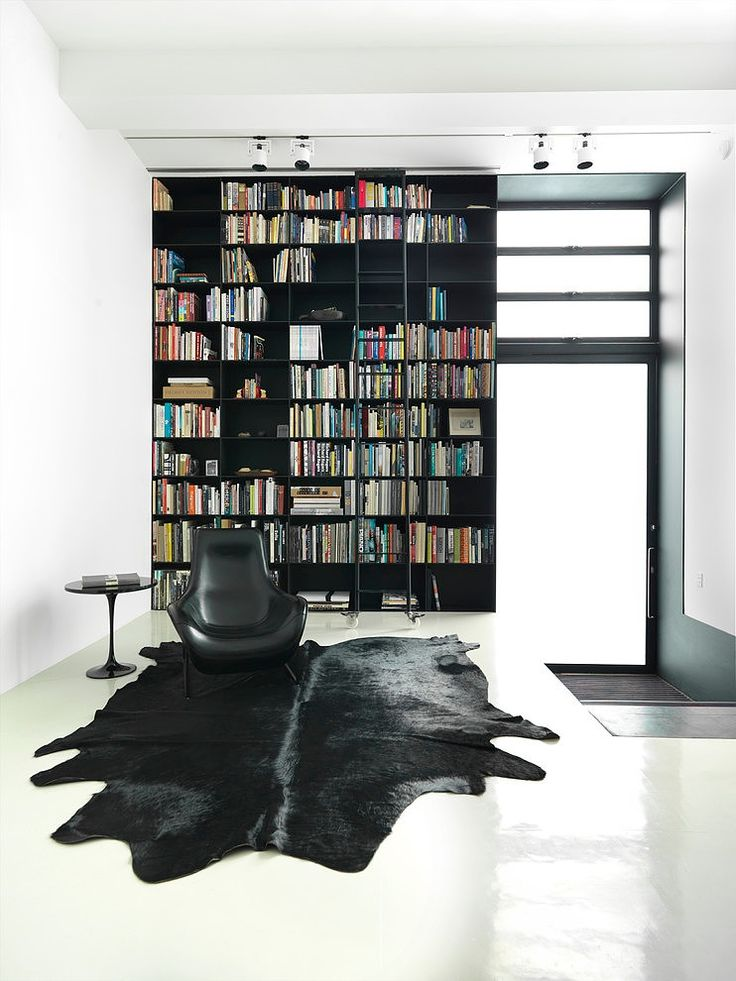 nice black and white library room strelein warehouse by ian moore architects