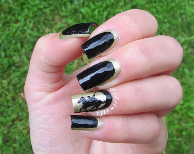 Black and gold ruffian manicure with thoroughbred reverse accent nail
