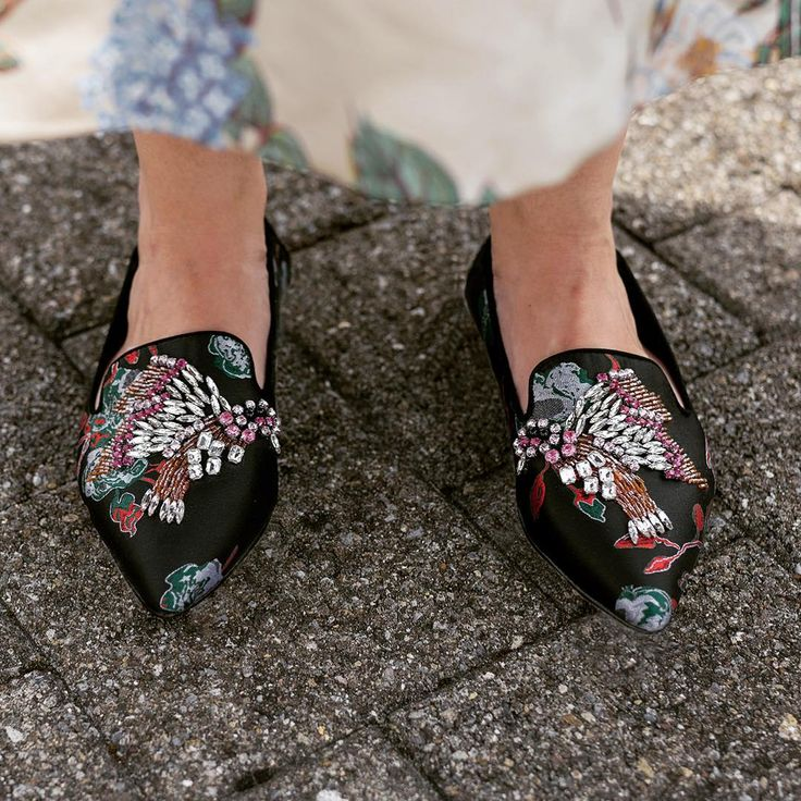 Black Flat Slippers.  Introducing Opal from KG Kurt Geiger, an absolute must have for your bold slip ons collection. Set in a smooth black upper with eye catching print work and multi-coloured embellishment adding a luxe edge, complete with a pointed toe.  Photo by Jelmoli Women (@jelmoli)