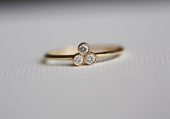 Pretty little ring. Three diamond ring. This ring is 14K gold but can be made in white or rose gold too. Perfect for layering. Perfect as a simple