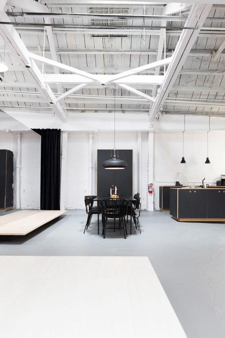 Danish brand Reform and US flooring company Madera have transformed a 1940s warehouse outside the Brooklyn Navy Yard into a Scandinavian-influenced showroom that displays hacked IKEA kitchens.