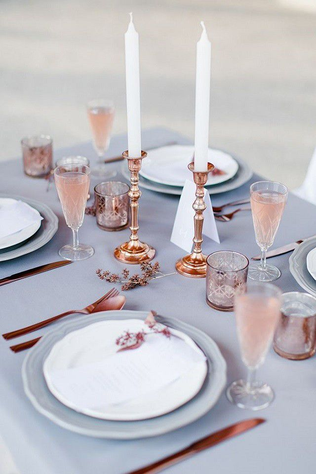 Rose Quartz & CopperPantone's colour of the year hasn't gone unnoticed, with rose quartz saturating everything we look at. Copper has also been trending, but the two together? They work wonders. This divine table setting pairs copper cutlery and candlesticks with rosé fizz. Palest peonies or ranunculus would work for flowers.  #refinery29 http://www.refinery29.uk/wedding-colour-schemes#slide-1