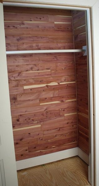 Cedar Closet - only top half of closet has the cedar.  Lower half is the lighter pine paneling.