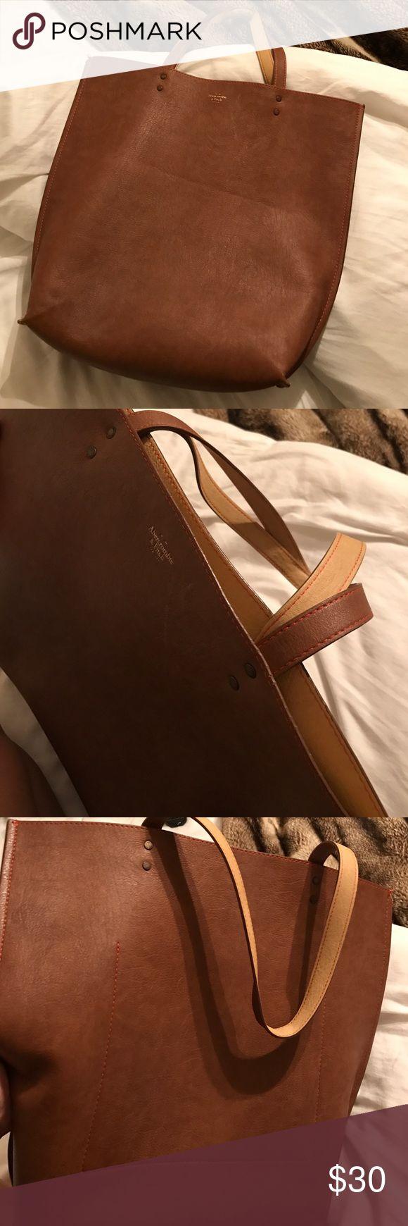 Reversible brown/tan bag/tote Brown/tan reversible Abercrombie bag/tote. + big pocket. Abercrombie & Fitch Bags