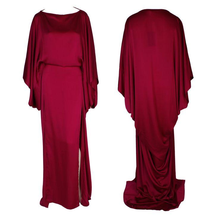 A brick red floor-length dress with a chic boat neck, side slit, and Kaftan sleeves by Plein Sud #pleinsud #brickred #elegance #gbmoda #greenbird #kaftan #trend #fashion #hautecouture #ramadan #dubaifashion #abudhabi #marinamall #luxury #dress