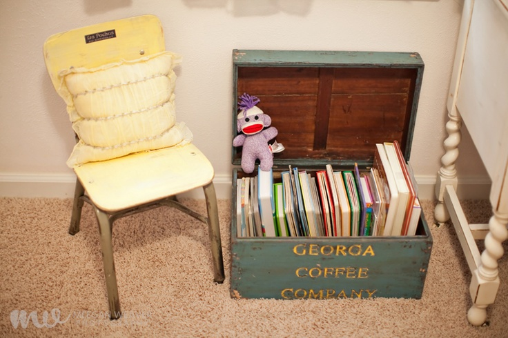 love this yellow chair and pillow i found at Alley Cat Collective and the beginning of Calyn's book collection