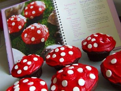 "Red Icing, chocolate cupcakes, white choc chips inverted to make ""spots"", little toad stools..easy, cute, and quick!"