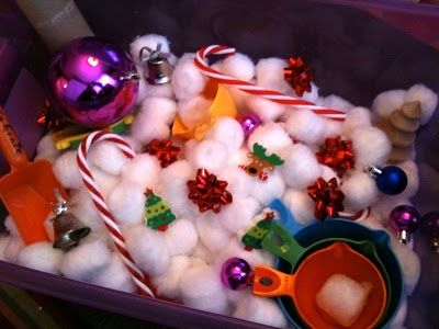 Christmas Sensory Bin - I like the idea of using cotton balls....Much cleaner than the sand in our bin now