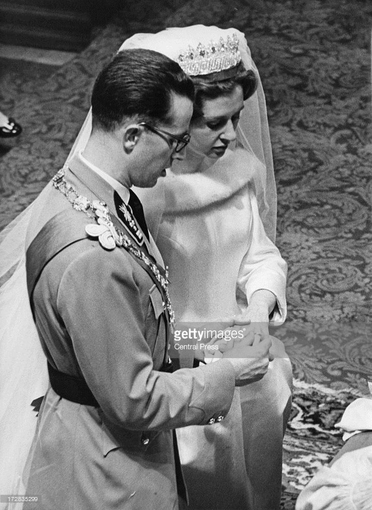 King Baudouin of Belgium (1930 - 1993) places the ring on the finger of Queen Fabiola of Belgium during their wedding ceremony at the Cathedral of St. Michael and St. Gudula, Brussels, 15th December 1960. (Photo by Central Press/Hulton Archive/Getty Images)