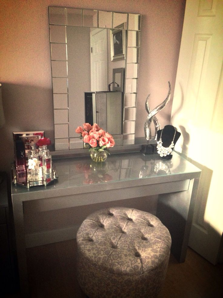 My makeup area is finally coming together. Malm dressing table painted silver with Martha Stewart metallic paint.: