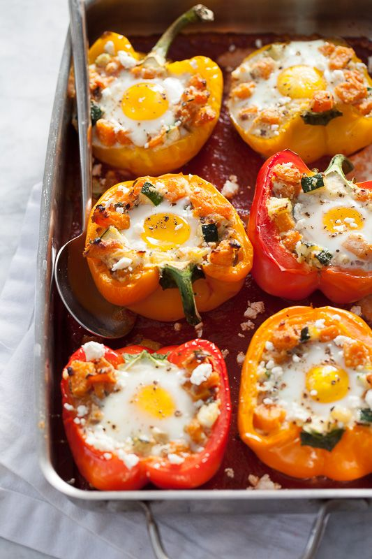 Baked Eggs in Stuffed Peppers cradle a sweet potato hash for the perfect fall brunch or dinner eats #recipe on foodiecrush.com