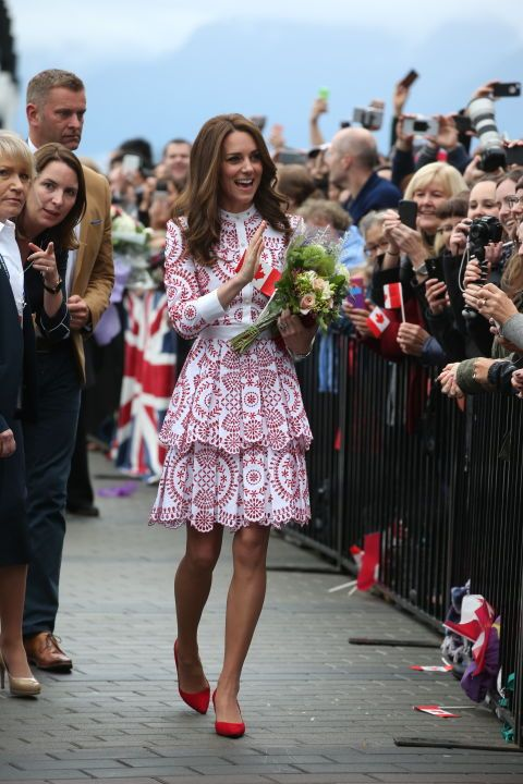 Kate wore a red-and-white patterned Alexander McQueen dress with red court shoes as she greeted crowds.