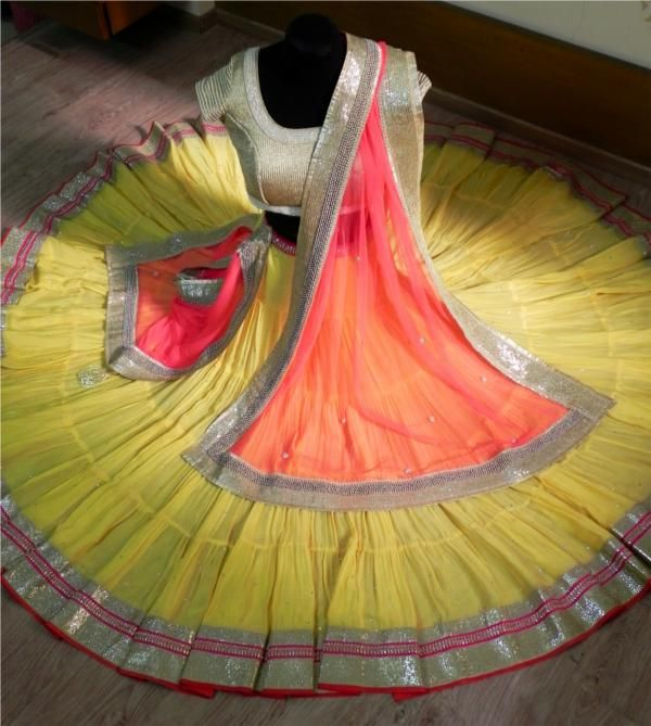 Pastel colours! Yellow lehanga with red, pink and gold border. Gold blouse. Orange red dupatta. Langao oni/ half saree/ ghagra.